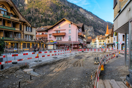 Interlaken, Switzerland Match 27 : Closure road - reconstruction and roadroller Reconstruction old road in Interlaken town at 27 march 2017,Switzerland Editorial