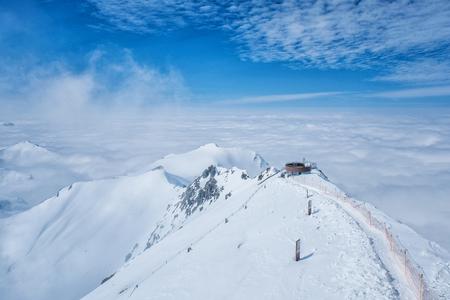 Stunning Panoramic view Snow moutain of the Swiss Skyline from Schilthorn Piz Gloria, Switzerland