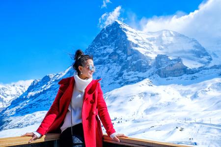 Young Woman Tourists see beautiful viewpoitn near Kleine Scheidegg station In daylight atI Switzerland Standard-Bild