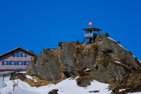 Wood watchtower in High snow mountain, along the railway from Interlaken to Jungfraujoch at Switzerland Editorial