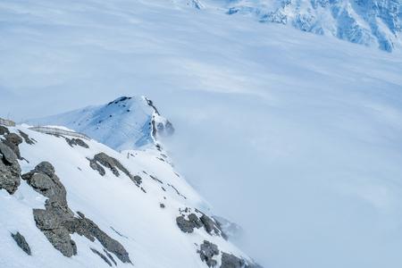 Stunning Panoramic view Snow moutain of the Swiss Skyline from Schilthorn, Switzerland