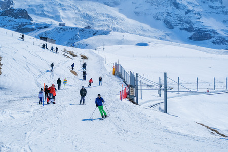KLEINE SCHEIDEGG - 27 MARCH : Train and hotel with the Eiger at Kleine Scheidegg, Switzerland on March 27, 2017. Kleine Scheidegg is a famous mountain pass attracting many tourists come to playing ski each year. Editorial