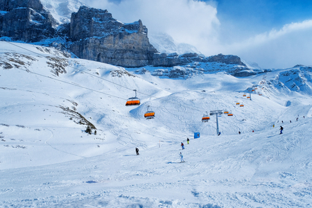 france station: Panoramic view of ski chair lift in high mountains in Switzerland