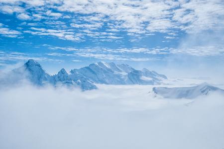 Stunning Panoramic view Snow moutain of the Swiss Skyline from Piz Gloria Schilthorn, Switzerland