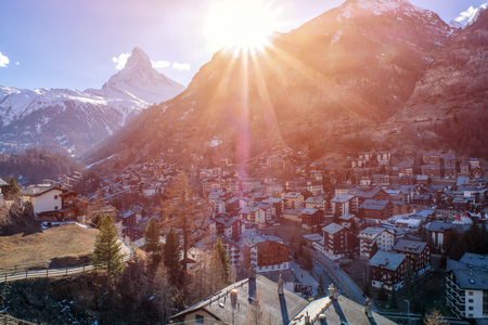 Beautiful view of old village in sunrise time with Matterhorn peak background in Zermatt, Switzerland.