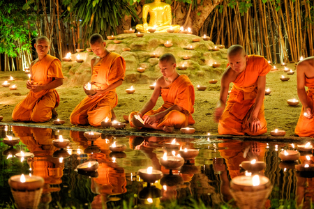 CHIANG MAI THAILAND - NOVEMBER 14 : Buddhist monks praying for the Loy Krathong festival at Wat Phan Tao on November 14, 2016 in Chiang Mai, Thailand.