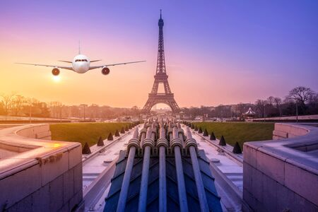Real airplane over the Cityscpae with the view of Eiffel Tower Paris, France Banco de Imagens