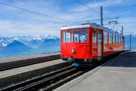 Famous electric red tourist swiss train on Rigi mountain,Switzerland,Europe 写真素材