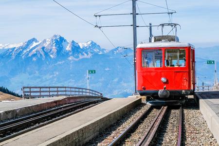 Famous electric red tourist swiss train on Rigi mountain,Switzerland,Europe Stock Photo