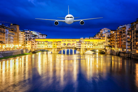 Front of real plane aircraft, on Ponte Vecchio bridge Nigth view of Florence, Italy background Reklamní fotografie