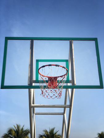 Basketball street court on blue sky background
