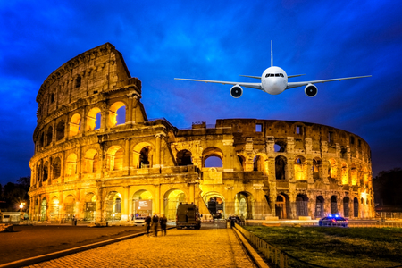 Front of real plane aircraft, on Colosseum Nigth view of Rome, Italy background