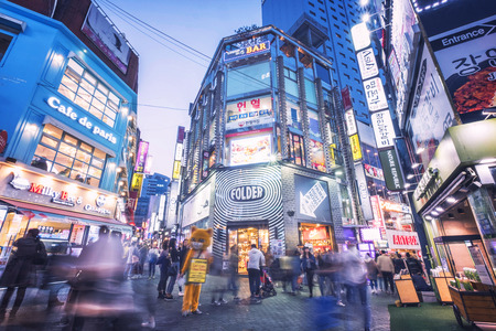 SEOUL, SOTH KOREA, 29 MARCH 2018 : Korean people and tourist walking around Myeong-dong  at night for shopping and eating. Myeong-dong is one of the busiest places and famous shopping destinations in Seoul, South Korea,
