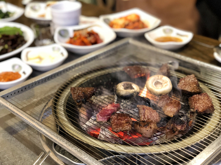 Grill meat on hot coals. This kind of food is a Korean or Japanese BBQ style. Reklamní fotografie