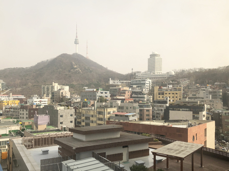 Cityscape rainy day view of Seoul and Namsan Seoul Tower, South Korea