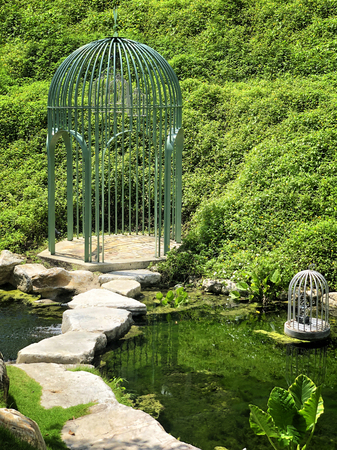 Big cage in a beautiful green garden Reklamní fotografie