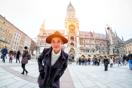 Young Woman Tourists selfie with mobile phone near the  Marienplatz town hall and Frauenkirche in Munich, Germany Reklamní fotografie