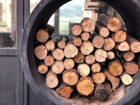 A pile of stacked firewood, prepared for cooking pizza in the Restaurant Reklamní fotografie - 114522683