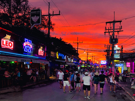 PHUKET, THAILAND JUNE, 2018: Tourists walking to see sunset view at street night market of Phuket, Thailand on June 16, 2018. Editorial