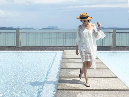 Summer holidays and vacation - Happy woman on the pool side in Phuket, Thailand Archivio Fotografico - 134765224