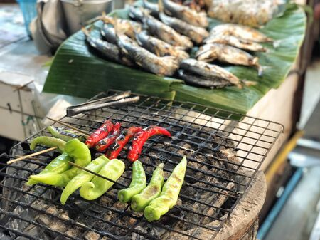Bell pepper grill on stove in street market