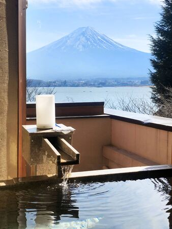 Outdoor hot-spring bath with the beautiful view of Mountain Fuji and Lake Kawaguchiko in Japan