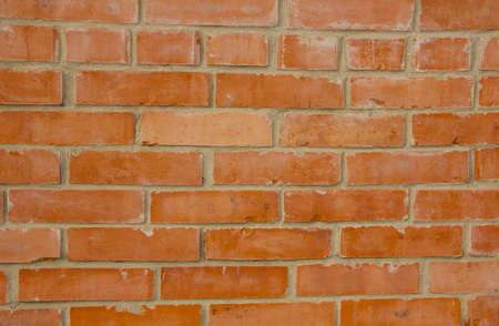 The texture of the brick is red. Background of empty brick basement wall 免版税图像