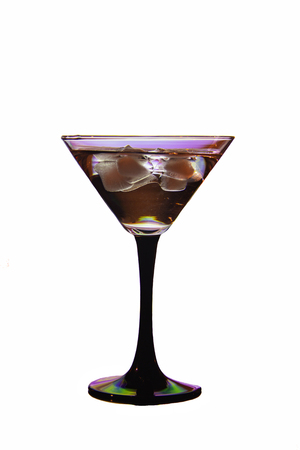 beautiful glass on a black leg with a cocktail and ice Stock Photo
