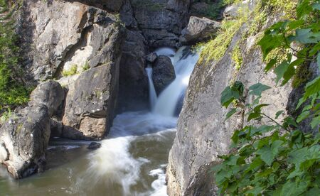 the beautiful small waterfall on the rapid river in the forest Stock fotó