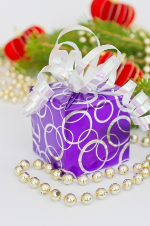 box with a gift and decoration of the christmas tree branches photo