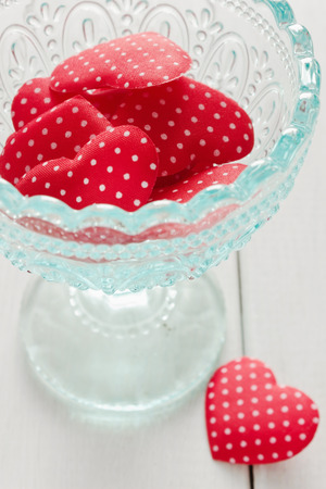 beautiful red valentines blue glass cup on the table photo