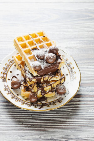 watered: freshly baked waffles on a plate watered chocolate