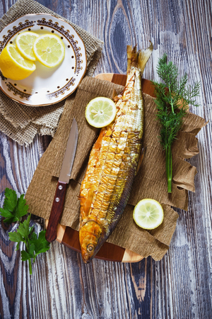 whitefish: smoked fish with lemon, dill and parsley on the table. whitefish Stock Photo