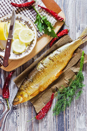 whitefish: smoked fish with lemon, dill, parsley and hot red pepper. whitefish. Stock Photo