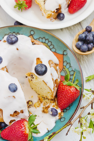 delicious summer cake with blueberries and strawberries on a plate. selective focus photo