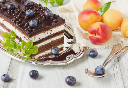birthday cake with blueberries and fresh apricots. selective focus photo