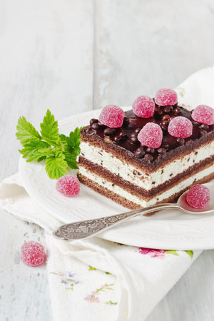 raspberry jelly: chocolate cake with raspberry jelly candies. copy space background Stock Photo