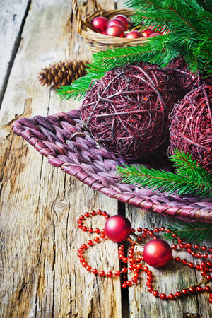 large christmas balls made of wire in a basket on old wooden background.copy space background photo