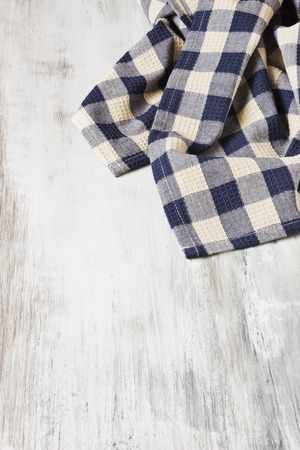 kitchen towel on a white painted wooden background. backgrounds and textures. copy space background photo