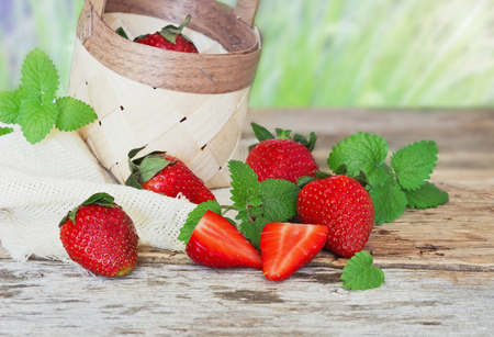 ripe strawberries on a wooden background. berries from his garden.health and diet food. selective focus