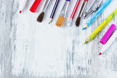 teaching crayons: school accessories on an old white wooden background. back to school concept. copy space bacground