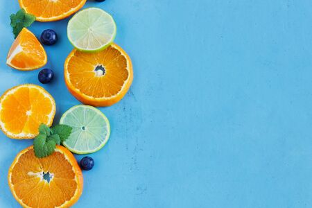sliced citrus fruit on a blue wooden background.health and diet concept. top view. copy space background