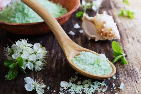 bath: bath salt on a rustic wooden background.aromatherapy spa concept Stock Photo