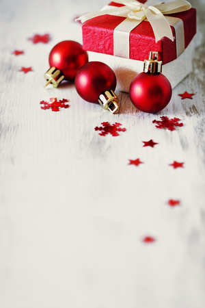 gift card: box with christmas gifts and christmas decorations on a white wooden background. selective focus. copy space for you text. image is tinted Stock Photo