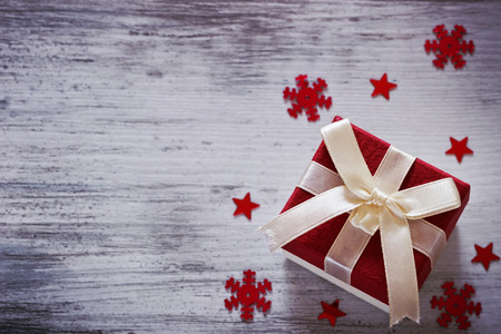 box with christmas gifts and christmas decorations on a white wooden background. copy space background. top view. image is tinted