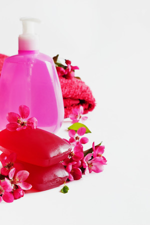 glycerin soap: Glycerin soap bars and liquid soap in a bottle with floral aroma on a white background. Health care and hygiene concept. Selective focus Stock Photo