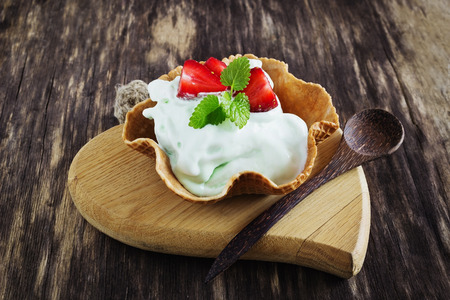 peppermint cream: homemade peppermint ice cream with waffles on a wooden heart. selective focus