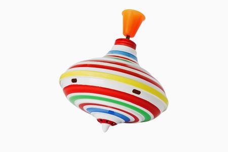 molinete: Perinola para los ni�os aislados sobre fondo blanco. el desarrollo de un juguete para ni�os Foto de archivo