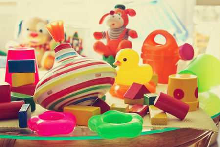 upbringing: childrens toys in the childrens room summer day. care and upbringing of the childs conception. toned image. selective focus