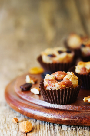 Homemade sweets with nuts, raisins and caramel. Oriental traditional cuisine. Selective focus